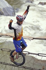 Unicyclist Crossing River On Unicycle