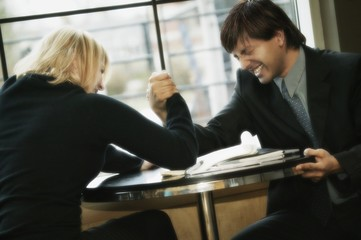 Business Couple Having Arm Wrestle