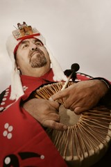 Native American Man Holding Ceremonial Drum