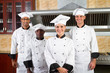 group of chefs in kitchen