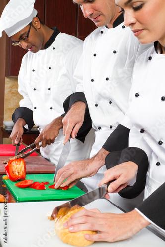 chefs cooking in industrial kitchen