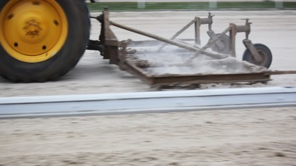 tractor with special plough goes on hippodrome track