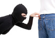 pickpocket in action - thief in balaclava