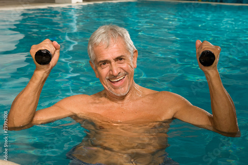 Portrait of elder man in the pool