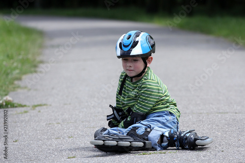 Preschooler falls over while rollerblading in the park
