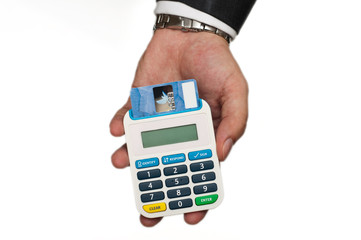 businessman holding a card reader with a credit card inside