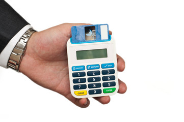 business mans holding a card reader with a credit card inside