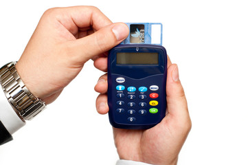 business man holding a card reader with a credit card inside