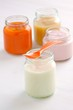 baby food: rice pudding, apple and carrot puree and yogurt