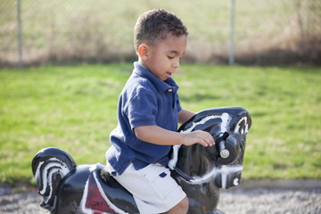 Multi-racial boy at the park