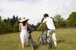 Back of couple riding bikes