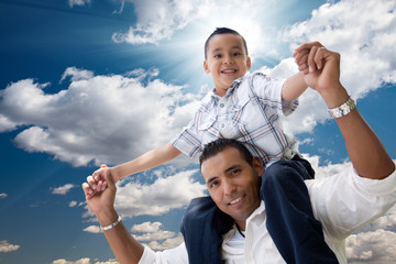 Hispanic Father and Son Having Fun Over Clouds