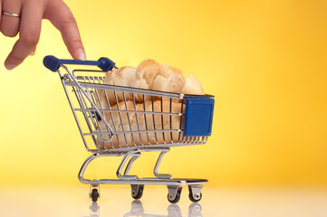 metal shopping trolley filled with bread