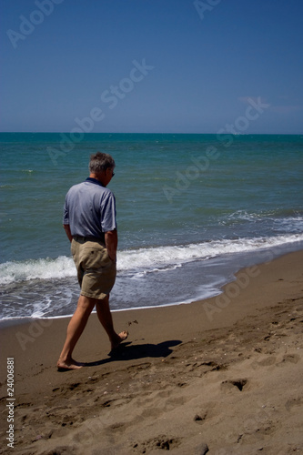 Mature man walking on the shore