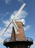 A Traditional Large Working Flour Milling Windmill. poster