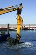marine dredging digging sea bottom black mud