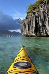 Amazing rocks and yellow sea kayak, Coron island, Philippines