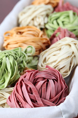 Tagliatelle pasta dyed with vegetables
