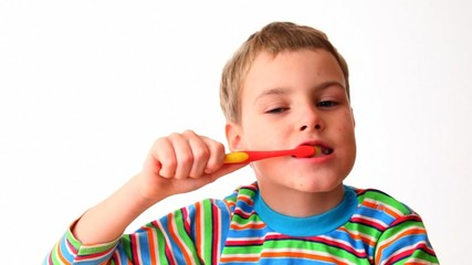 boy cleans teeth red tooth-brush