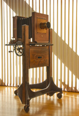 Antique mahogany wood view camera on rolling stand