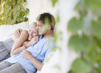Couple hugging and laying on porch