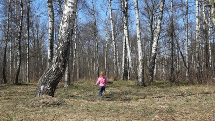 girl runs from camera to spring brich grove