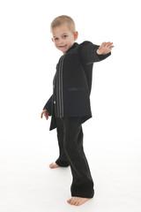 Adorable little boy pretending to be a rockstar