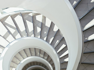 """Directly above modern, spiral staircase"""
