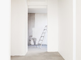 Ladder and freshly painted walls in empty house
