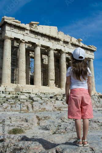 Child in front of Ancient Parthenon in Acropolis Athens Greece.