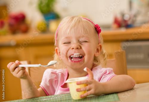 little girl eating yoghurt