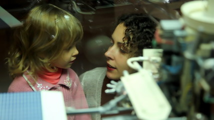 mother telling  girl about space exhibit in space museum