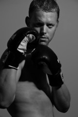 handsome male wearing boxing gloves