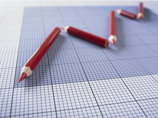 Close up of red pencils forming graph