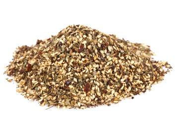 Zaatar-  a blend of herbs, sesame seeds and salt in pile on whit