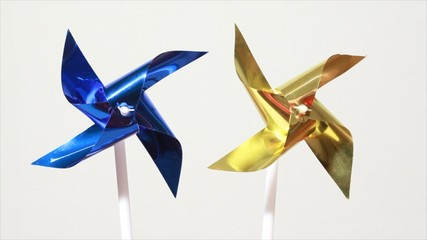 Blue and yellow propeller spins under influence of air flow