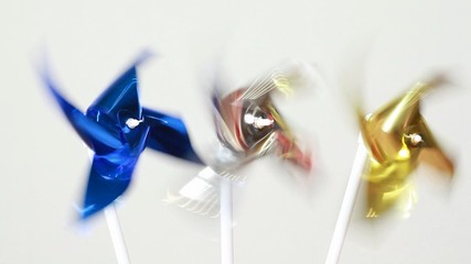Blue, metallic and yellow propeller spins