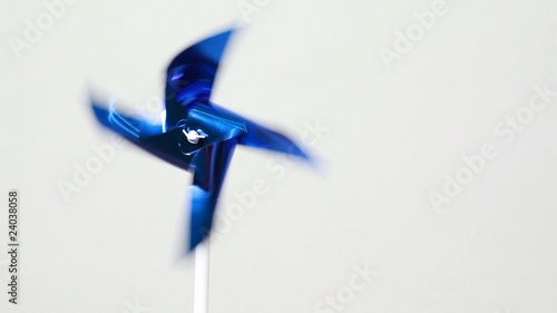 Blue plastic propeller spins under influence of air flow