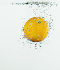 Close up of orange splashing in water