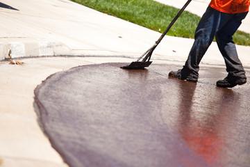 Road Worker Resurfacing Street