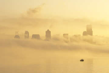 """Silhouette of Seattle highrises through fog, Washington"""