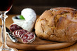 French sausage with loaf of bread and wine