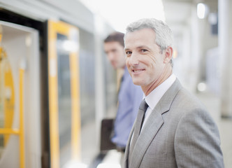 Businessman about to enter train at train station