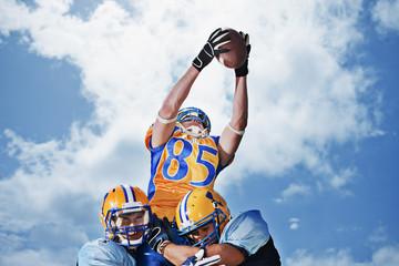 Football player catching football