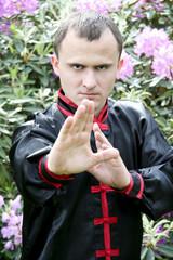Man exercising martial arts outdoors