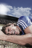 Frustrated soccer player laying on ground