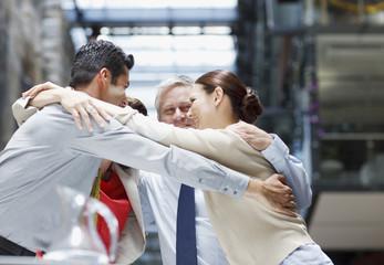 Business people hugging