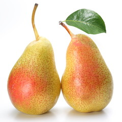 Two appetizing pears with a leaf.