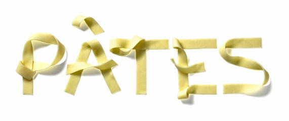 "the word ""pâtes""written with tagliatelles"