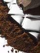 bar of dark chocolate and chocolate powder